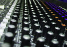 Rows of Knobs on Soundboard Stock Image