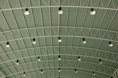Rows of lamps line the ceiling. The rows of lamps line the ceiling Royalty Free Stock Photos