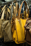 Rows of leather bags in store. Royalty Free Stock Photography