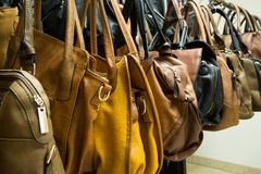 Rows of leather bags in store. Stock Photos