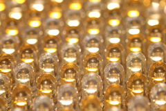 Rows of LED Light Bulbs. In yellow and white, forming a pattern Stock Photo