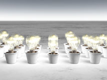Rows of light bulbs with cold light. And with different sizes are growing in white pots that lie on a white and gray abstract ground Royalty Free Stock Image