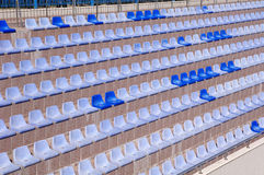 Rows of  light and dark  blue plastic stadium seats Stock Photo