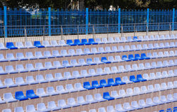 Rows of light and dark blue plastic stadium seats Royalty Free Stock Image