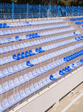 Rows of  light and dark  blue plastic stadium seats Stock Images