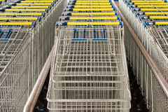 Rows of lined-up Shopping Carts Royalty Free Stock Images