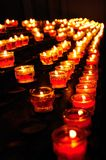 Rows of lit prayer candles Royalty Free Stock Photography
