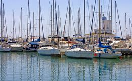 Rows of luxury yachts in Duquesa port in Spain on the Costa del. Rows of luxury yachts and masts in Duquesa port in Spain on the Costa del Sol stock photos