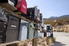 Rows of mailboxes by dusty road Stock Photo