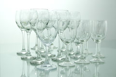 Rows of many empty wine glasses on a table Stock Image