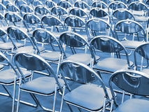 Rows of metal chairs Stock Images