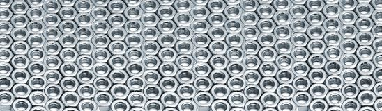 Rows of metal hex nuts Royalty Free Stock Images