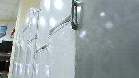 Rows of modern fridges in a store stock video footage