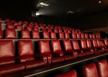 Rows of modern reclining seats in a movie theater royalty free stock image