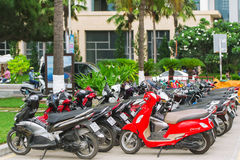 Rows of motorbikes parked outside a public building in Nha Trang. Royalty Free Stock Photo