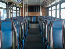 Rows of multiple leather blue empty seats on commuter bus royalty free stock photos