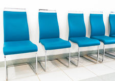 Rows of new chairs metallic colors in turquoise in the conference hall Royalty Free Stock Images