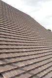 Rows of new tiles fixed to roof Stock Photo