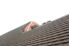 Rows of new tiles fixed to roof Stock Images