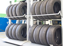 Rows Of New Tires On Rack. Stock Photo