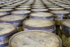Rows of oak barrels in bourbon distillery. Used oak barrels in bottling facility of Kentucky distillery stock image