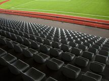 Free Rows Of Empty Seats In A Sports Stadium With Green Grass. Royalty Free Stock Photos - 187251868