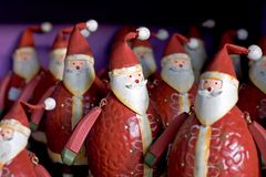 Free Rows Of Funny Santas For Sale On A Shelf Stock Photo - 365450