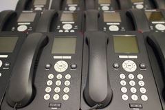Rows of office IP phones Royalty Free Stock Photos