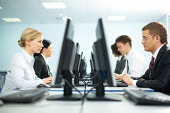 Rows of office workers Royalty Free Stock Photo