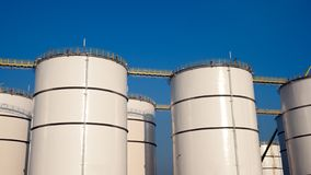Rows of oil storage silo Royalty Free Stock Images