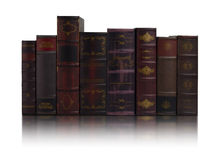 Rows of old books. In background white Royalty Free Stock Photo
