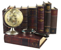 Rows of old books. With a globe and magnifying glass Royalty Free Stock Images