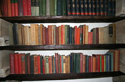 ROWS OF OLD BOOKS. Collection of old books on a makeshift shelf Stock Images