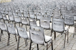 Rows of old empty chairs on square, Vienna Royalty Free Stock Photos