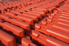 Rows of Orange Security Barriers Royalty Free Stock Photography