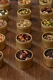 Rows of organic herbal tea in tins Stock Photos