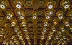 Rows of ornate, golden lanterns in a Buddhist temple Royalty Free Stock Image