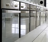 Rows of ovens in a store. Rows of modern ovens in a store Royalty Free Stock Images