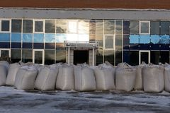 The rows of pallets with big bags in stock, for further unloading and processing . stock photos