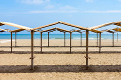 Rows of the palm leaf sun shades on the beach Royalty Free Stock Image