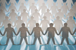 Rows of paper cut figures Stock Images