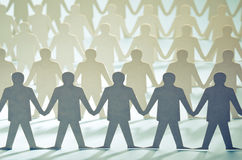 Rows of paper cut figures Stock Image