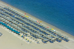 Rows of parasols on beach Stock Image