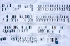 Rows of parked cars covered with snow. parking lot with vacant parking places. Drone photo stock photo