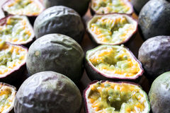 Rows of passion fruit. Sliced & whole with selective focus - great background image Royalty Free Stock Photography
