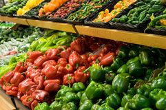 Rows of peppers. In a market Royalty Free Stock Image