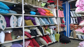Rows of pillows on shelves selling Stock Photography