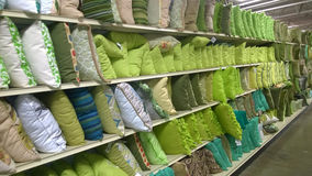 Rows of pillows on shelves selling Royalty Free Stock Images