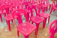 Rows of pink plastic chairs. In meeting room royalty free stock photos