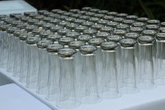 Rows of pint glasses on reception tables Stock Photography